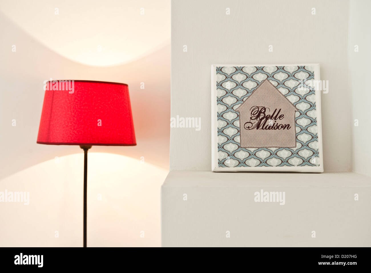 Red lamp with picture, House furnished in country style, Hamburg, Germany - Stock Image