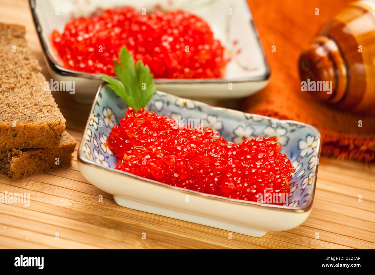 caviar red bowls two bread napkin - Stock Image