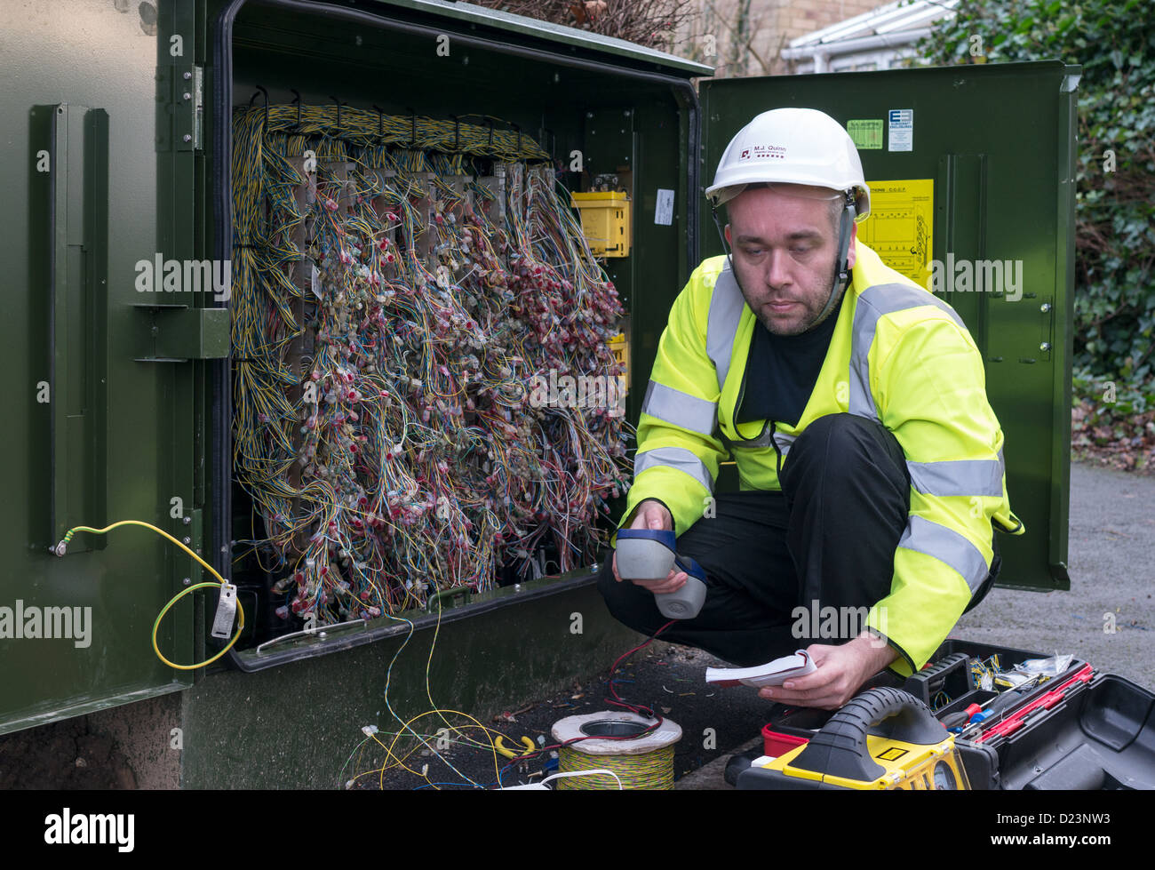 a-technician-installing-fibre-optic-broa
