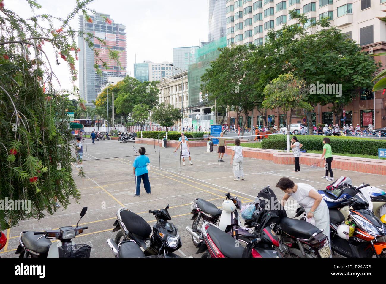 early morning badminton near Saigon River in downtown; Ho Chi Minh City; Vietnam - Stock Image