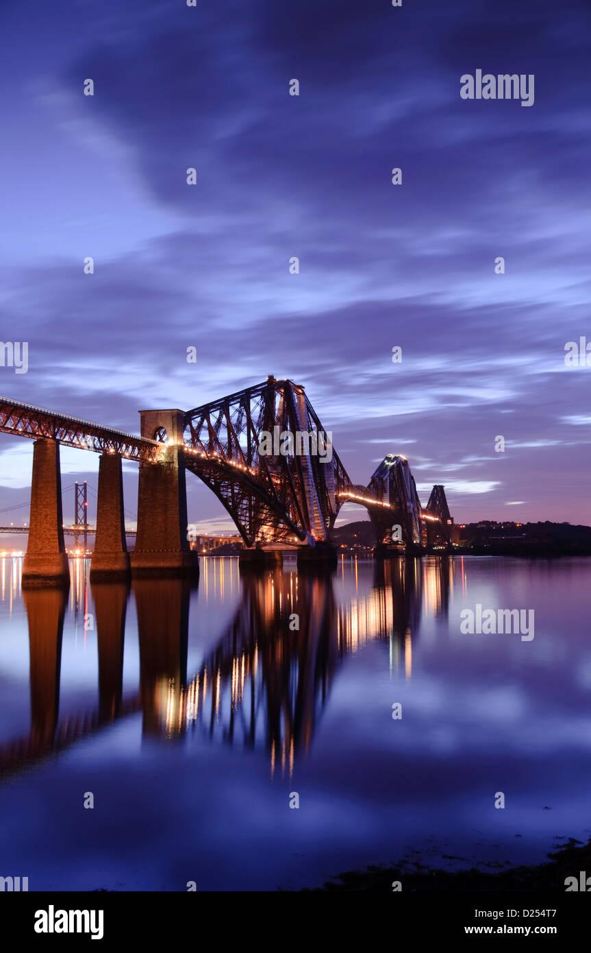 Beautiful view of the Forth Rail Bridge illuminated at night - Stock Image