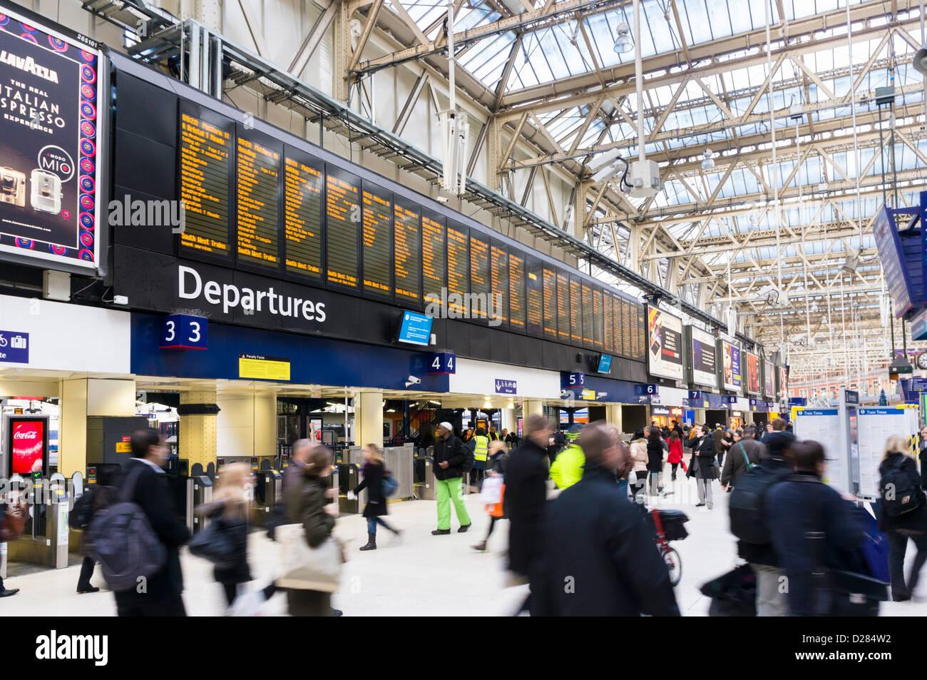 Commuters, passengers, London, England, UK - Waterloo station train station - Stock Image