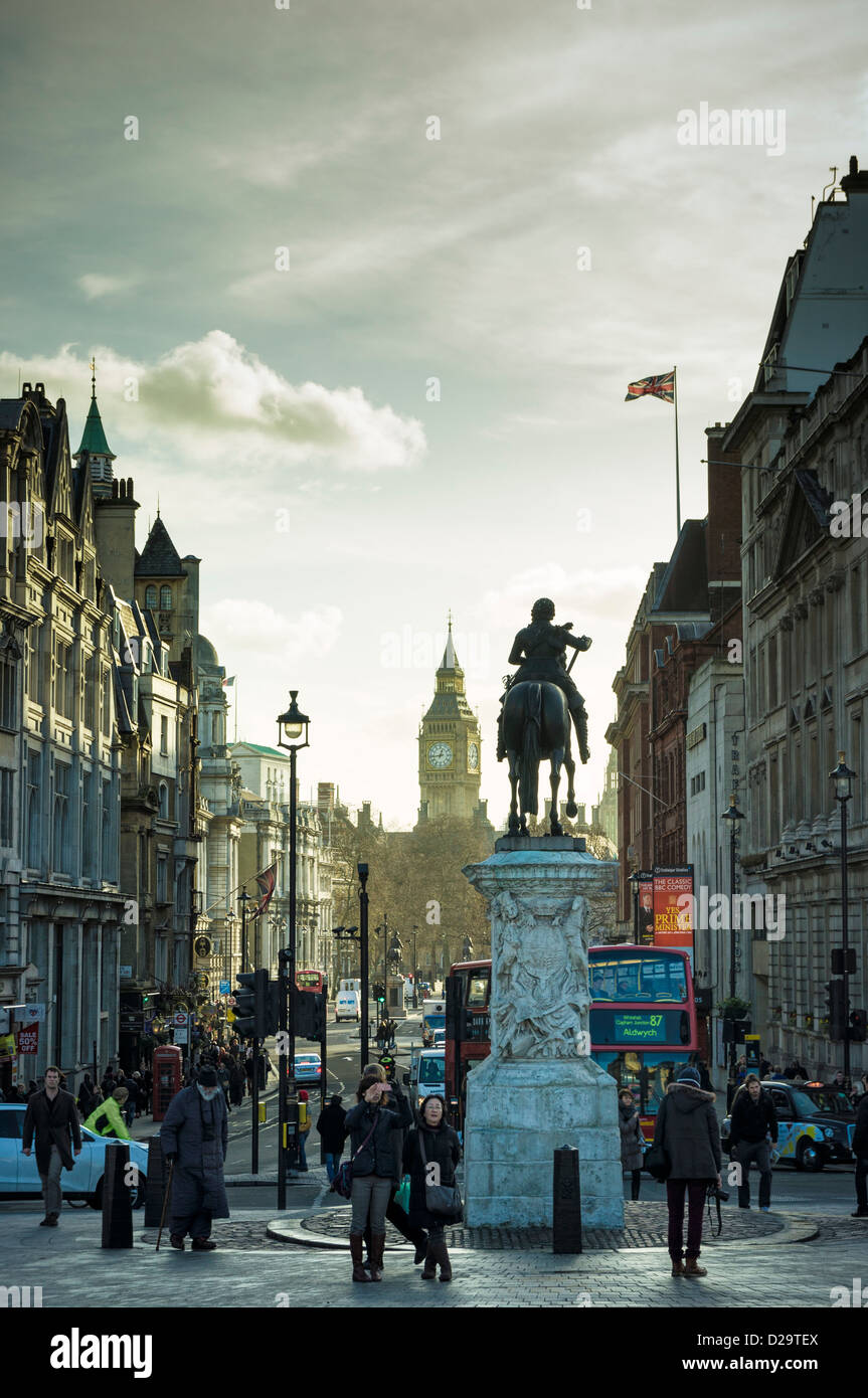 Looking down the London street of Whitehall towards the Houses of Parliament, London, UK in the late afternoon in - Stock Image