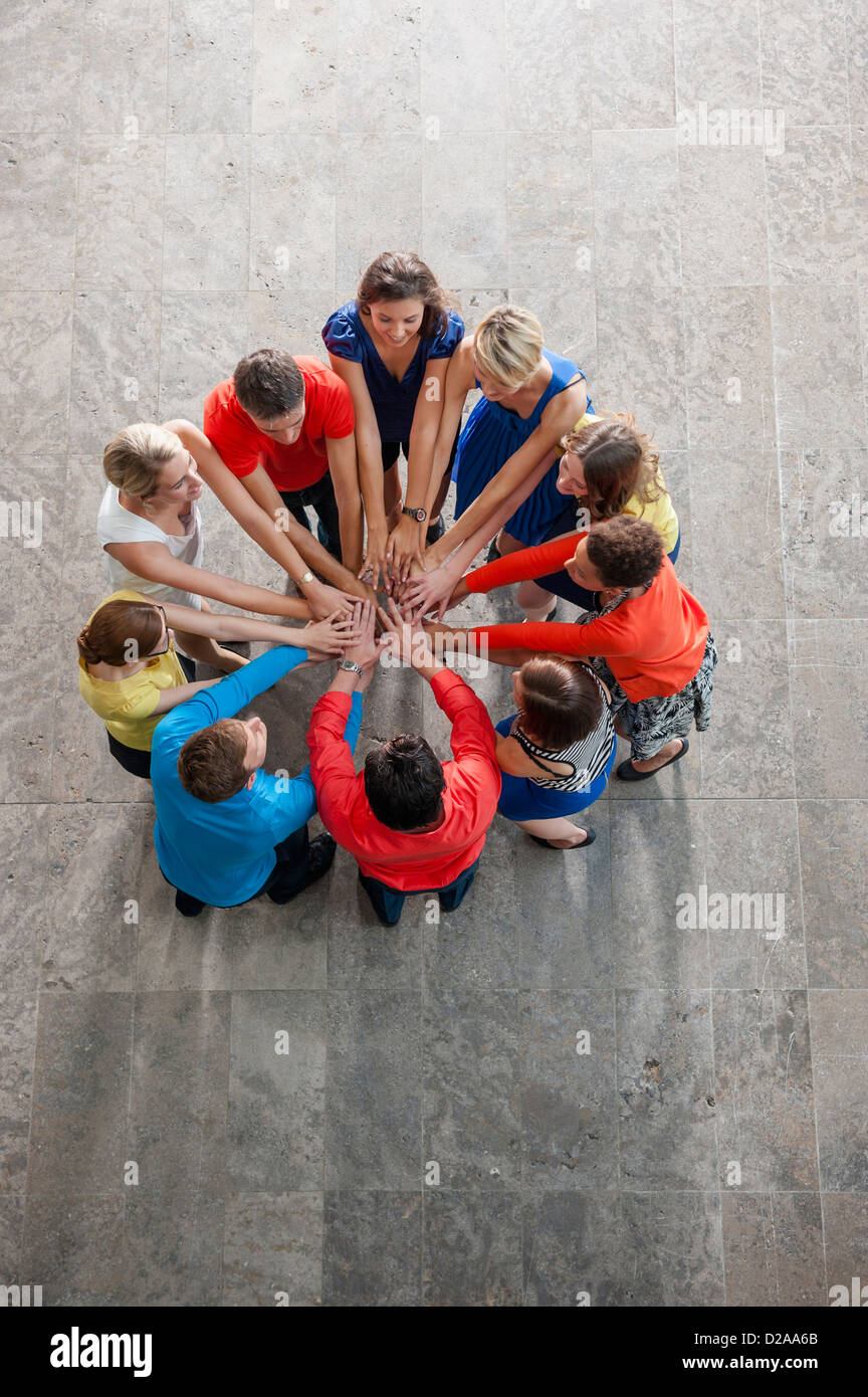 Overhead view of people cheering - Stock Image