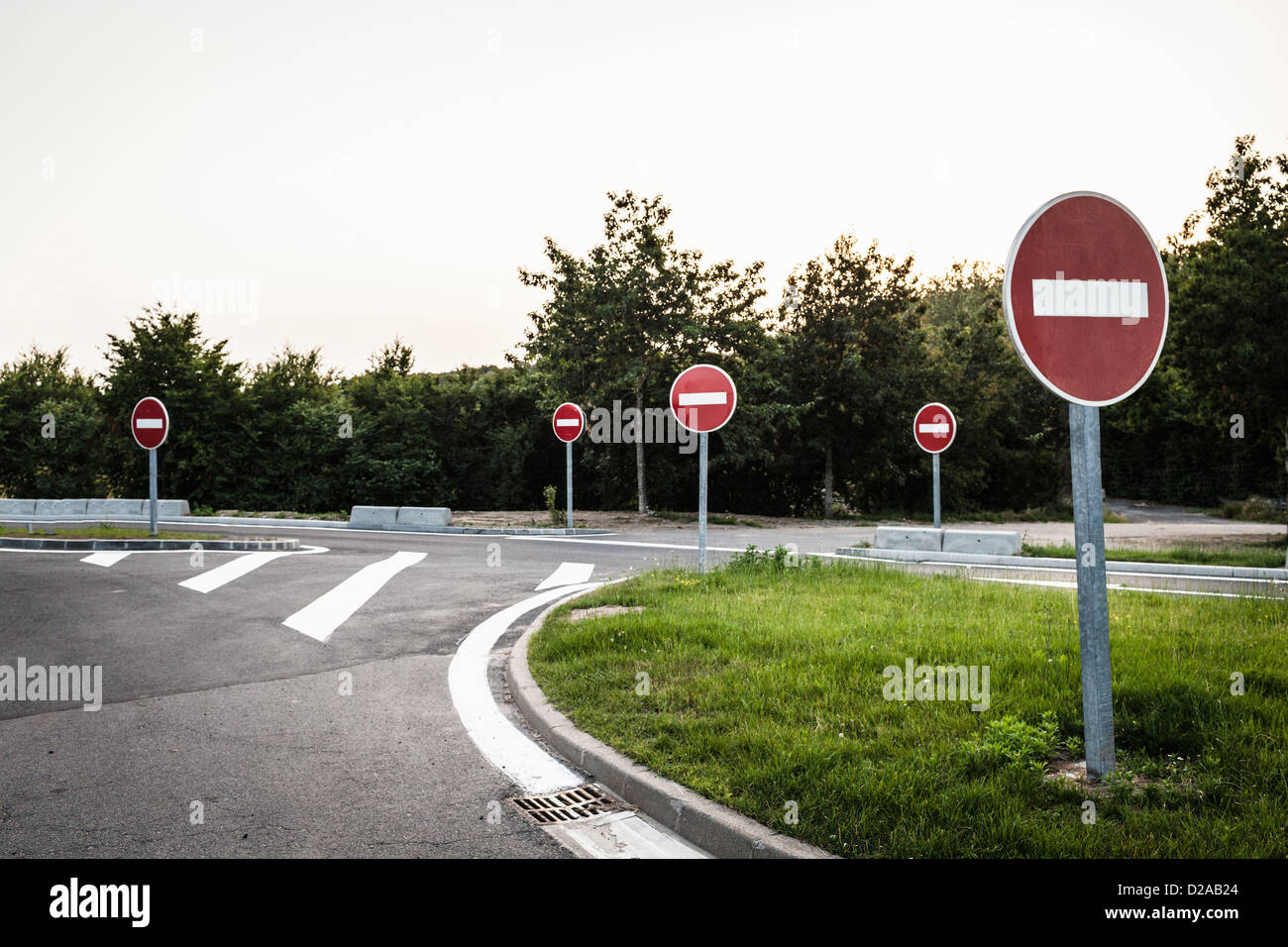No entry signs on rural road - Stock Image