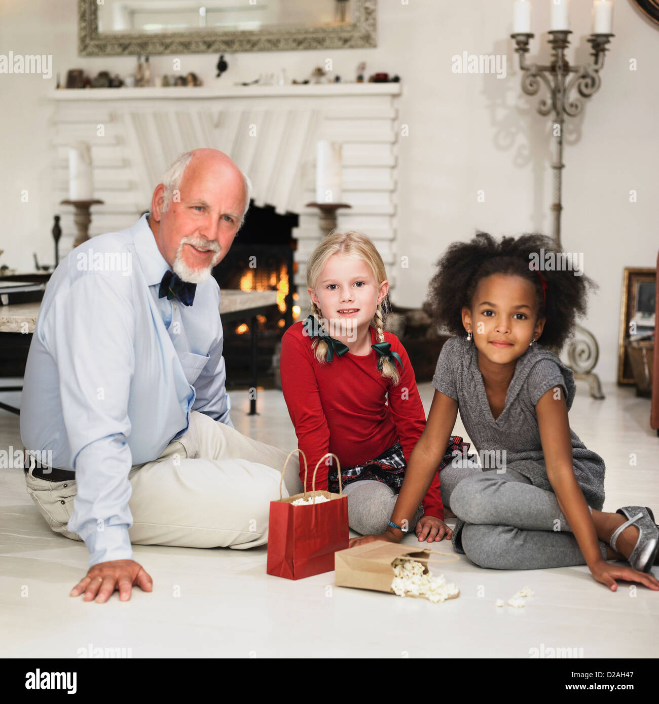 Older Man And Girls With Christmas Gifts Stock Photo 53093383 Alamy
