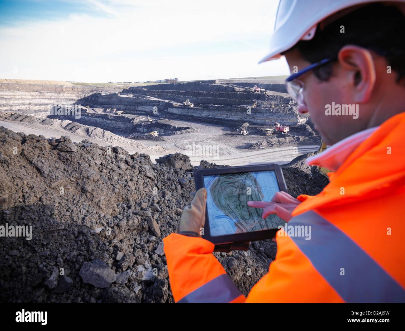 Ecologist examining surface coal mine - Stock Image