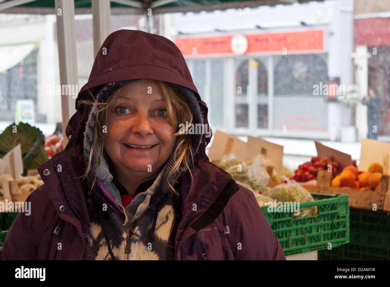 https://c7.alamy.com/comp/D2AM1R/happy-market-trader-at-her-fruit-and-vegetable-stall-in-the-town-centre-D2AM1R.jpg