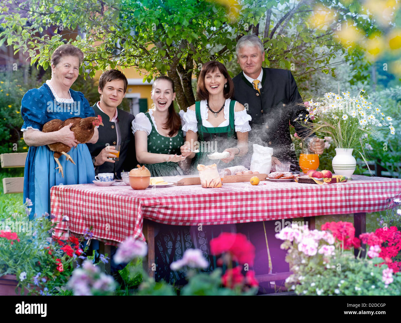 Family in traditional Bavarian clothes - Stock Image