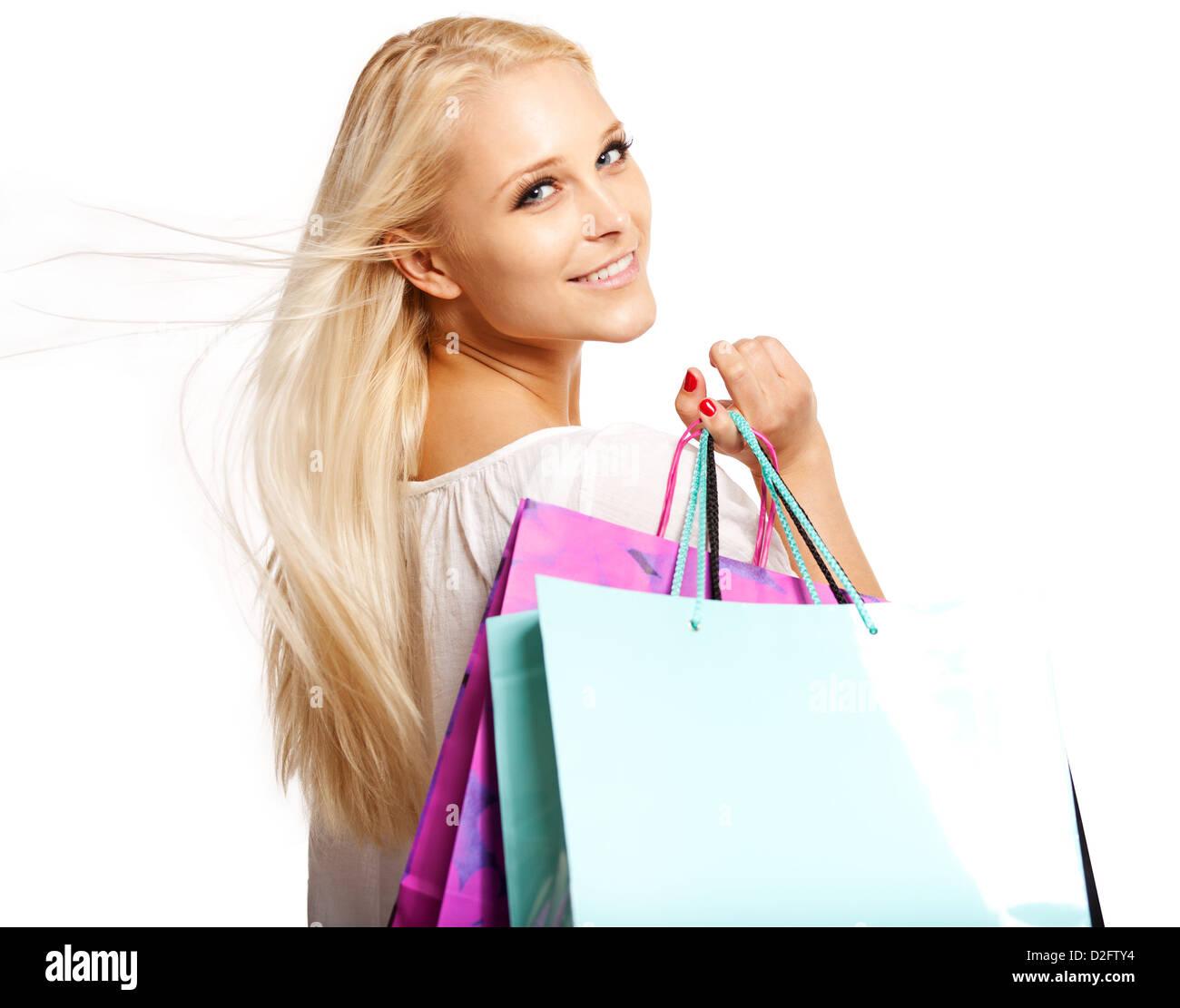 Shopaholic with shopping bags isolated on white background - Stock Image
