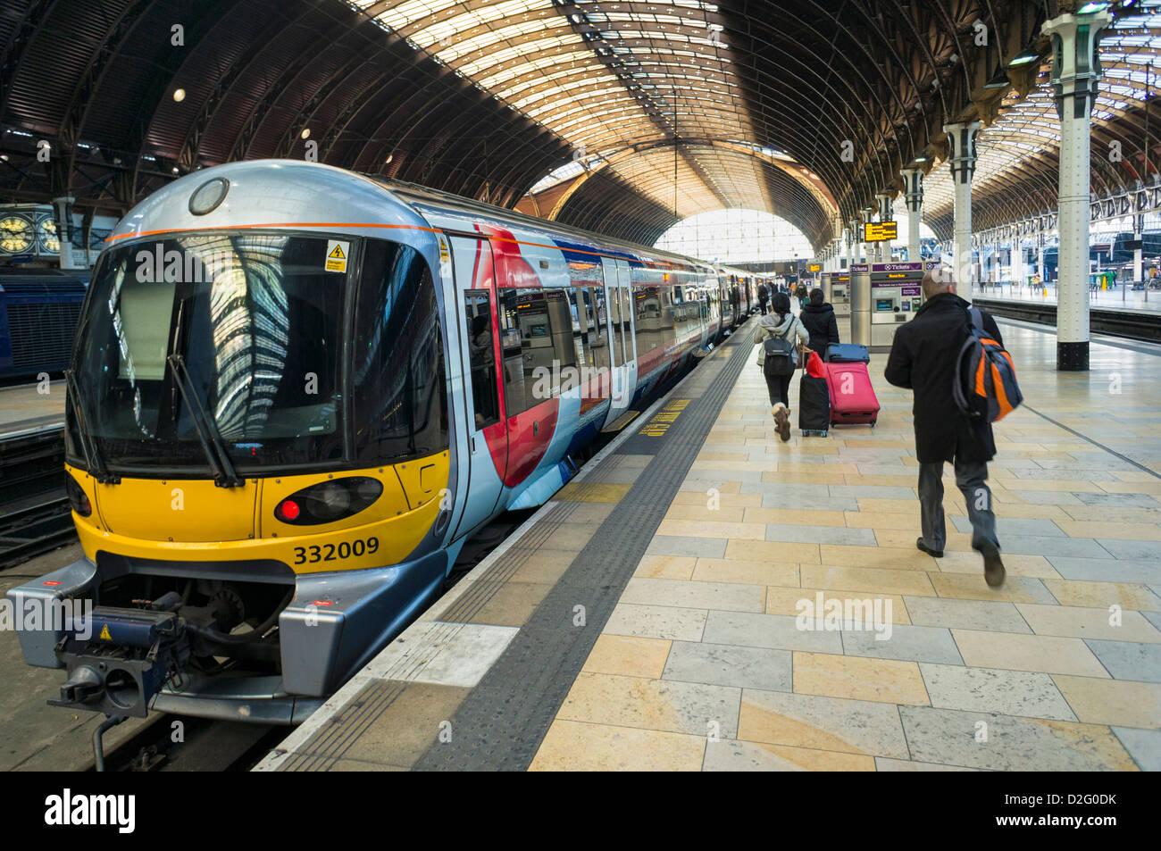 Train platform at Paddington station, London, train station, UK with people boarding a train - Stock Image