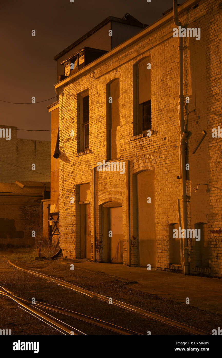 back-alley-abandoned-warehouse-at-night-