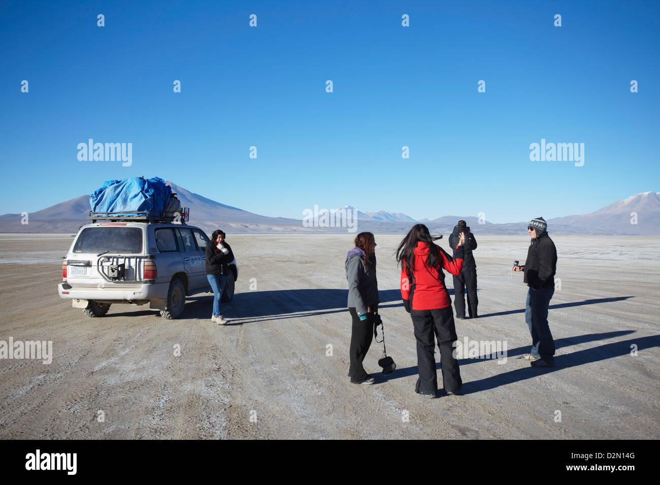 Tourists and jeep on Altiplano, Potosi Department, Bolivia, South America - Stock Image