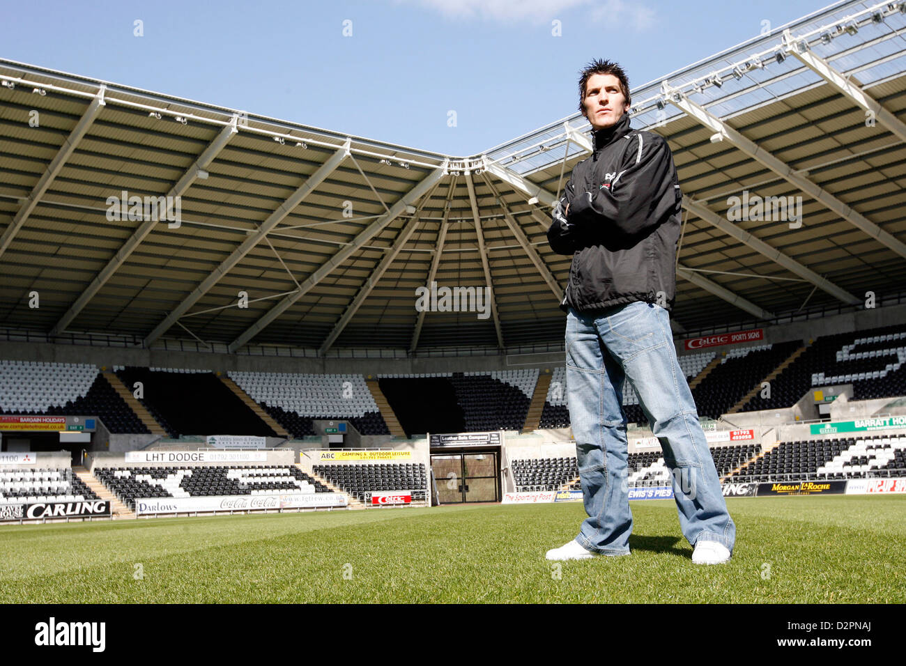 Professional Rugby Player James Hook standing on the pitch at the Liberty Stadium, Swansea. - Stock Image