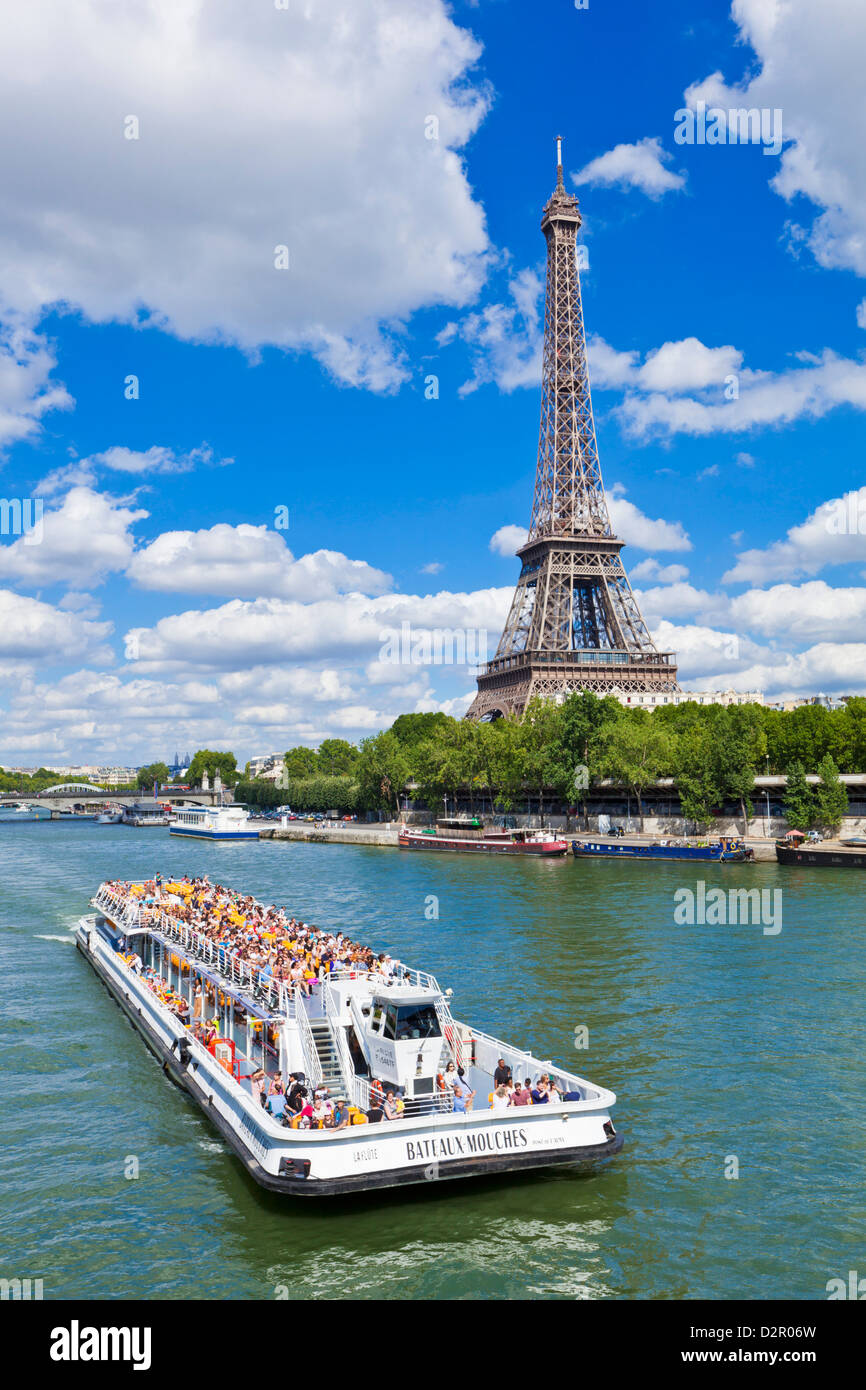 Bateaux Mouches tour boat on River Seine passing the Eiffel Tower, Paris, France, Europe - Stock Image