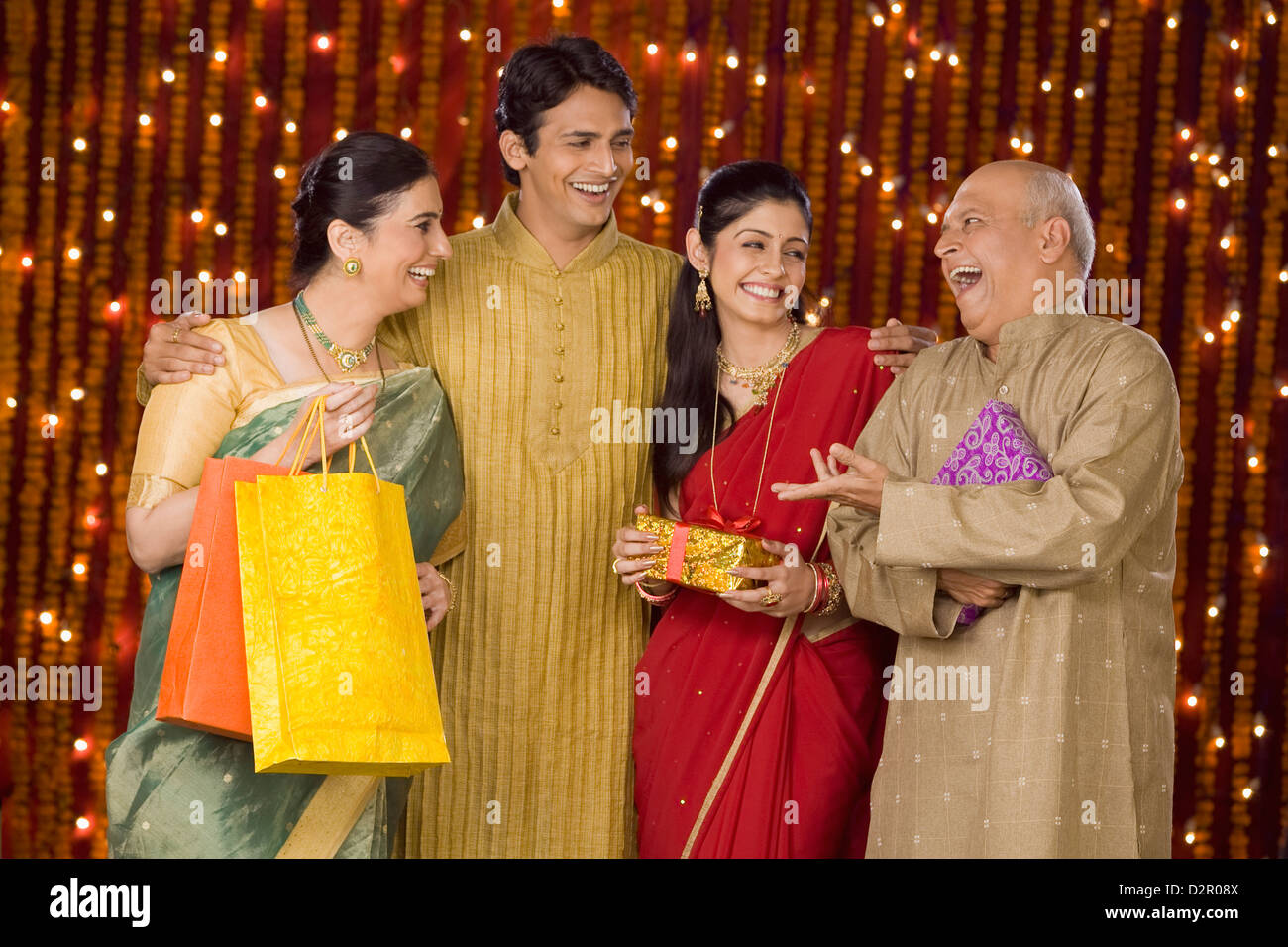 Family with shopping bags and Diwali gift Stock Photo: 53365562 - Alamy for Diwali Gifts For Family  143gtk