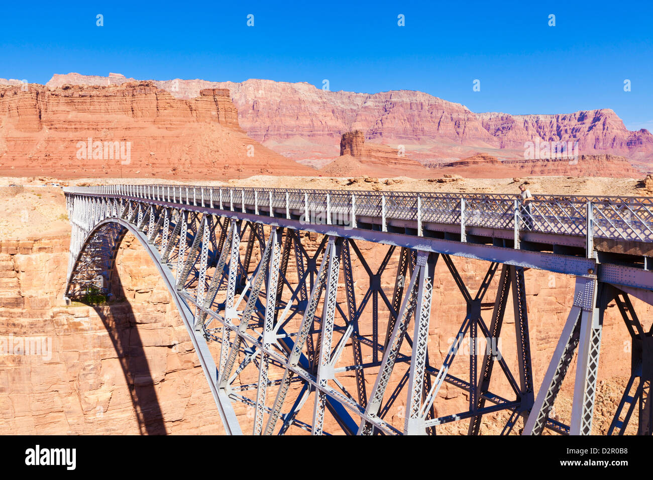 Lone tourist on Old Navajo Bridge over Marble Canyon and Colorado River, near Lees Ferry, Arizona, USA - Stock Image
