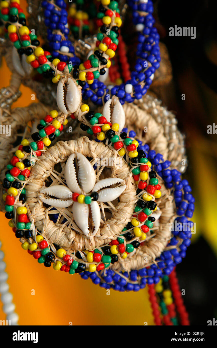 Candomble wear strings of beads made of seeds and shells in the colours of African gods. Cachoeira, Bahia, Brazil. - Stock Image