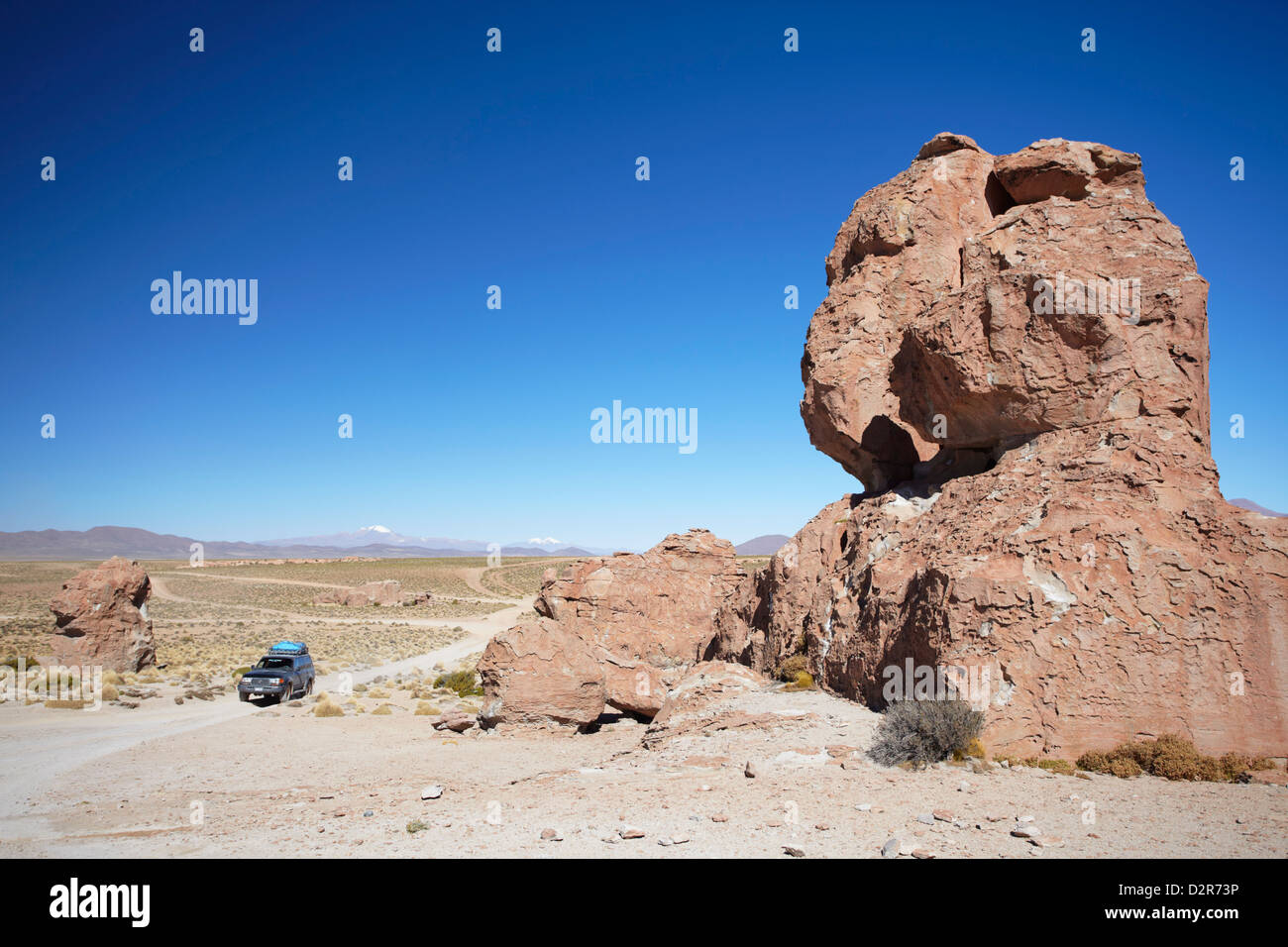 Jeep driving through rocky landscape on the Altiplano, Potosi Department, Bolivia, South America - Stock Image