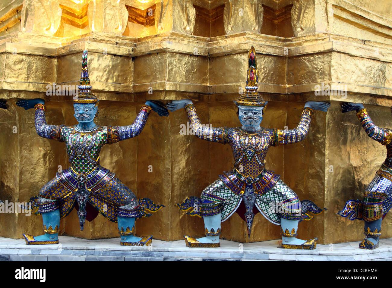 Demons, mythical creatures guarding the Golden Stupa, also known as Phra Sri Ratana Chedi - Grand Palace, Bangkok, - Stock Image