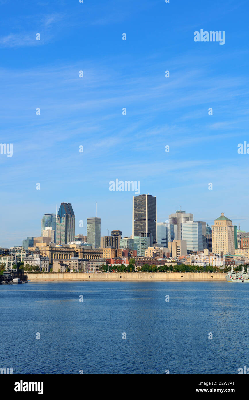 Montreal city skyline over river in the day with urban buildings - Stock Image