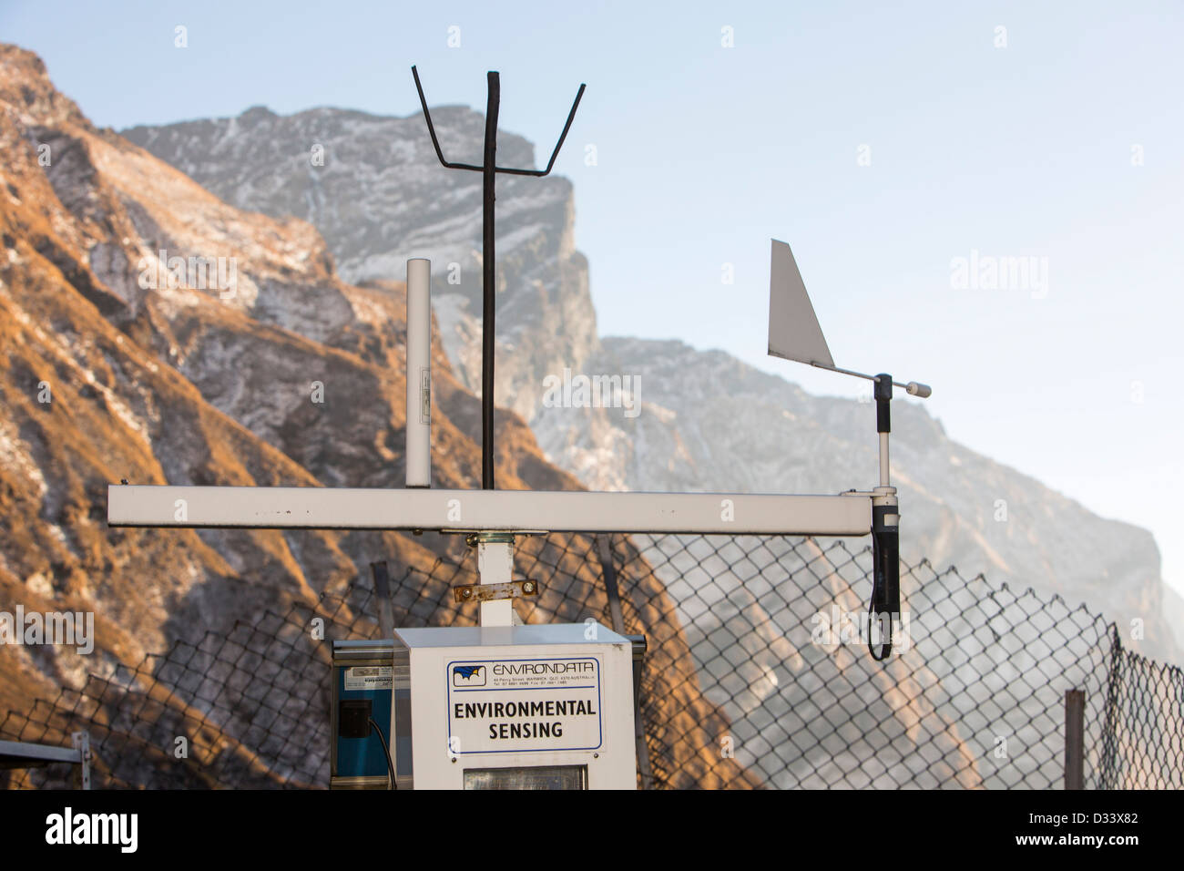 An automated weather station being powered by solar panels at Machapuchare Base Camp, Himalayas, Nepal. Stock Photo