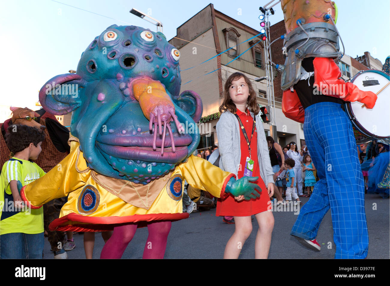 big-nazo-masked-musicians-dancing-on-the-street-with-children-during-D3977E.jpg