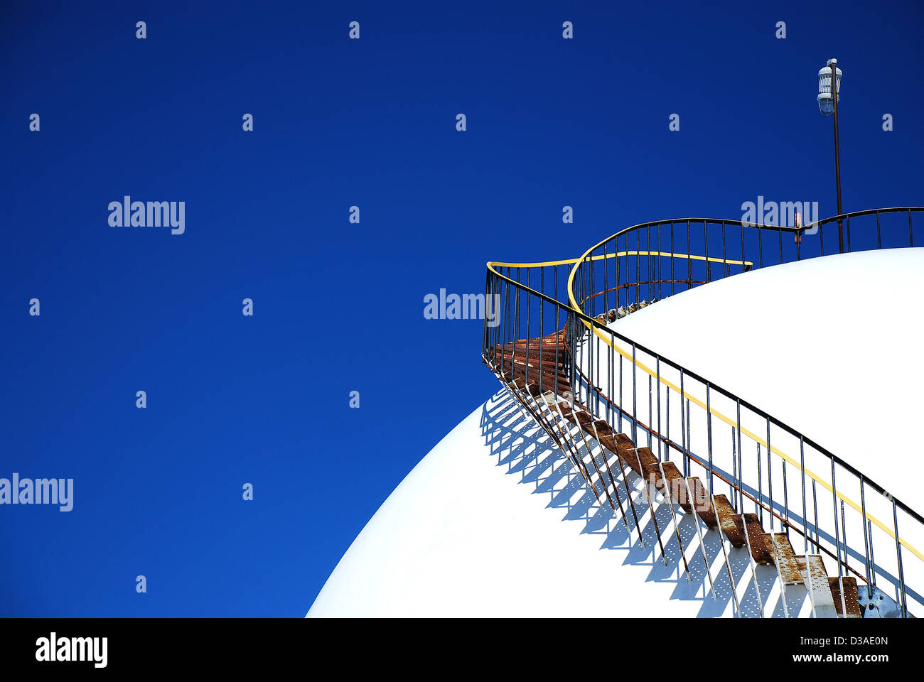 Gas storage tank and ladder. - Stock Image