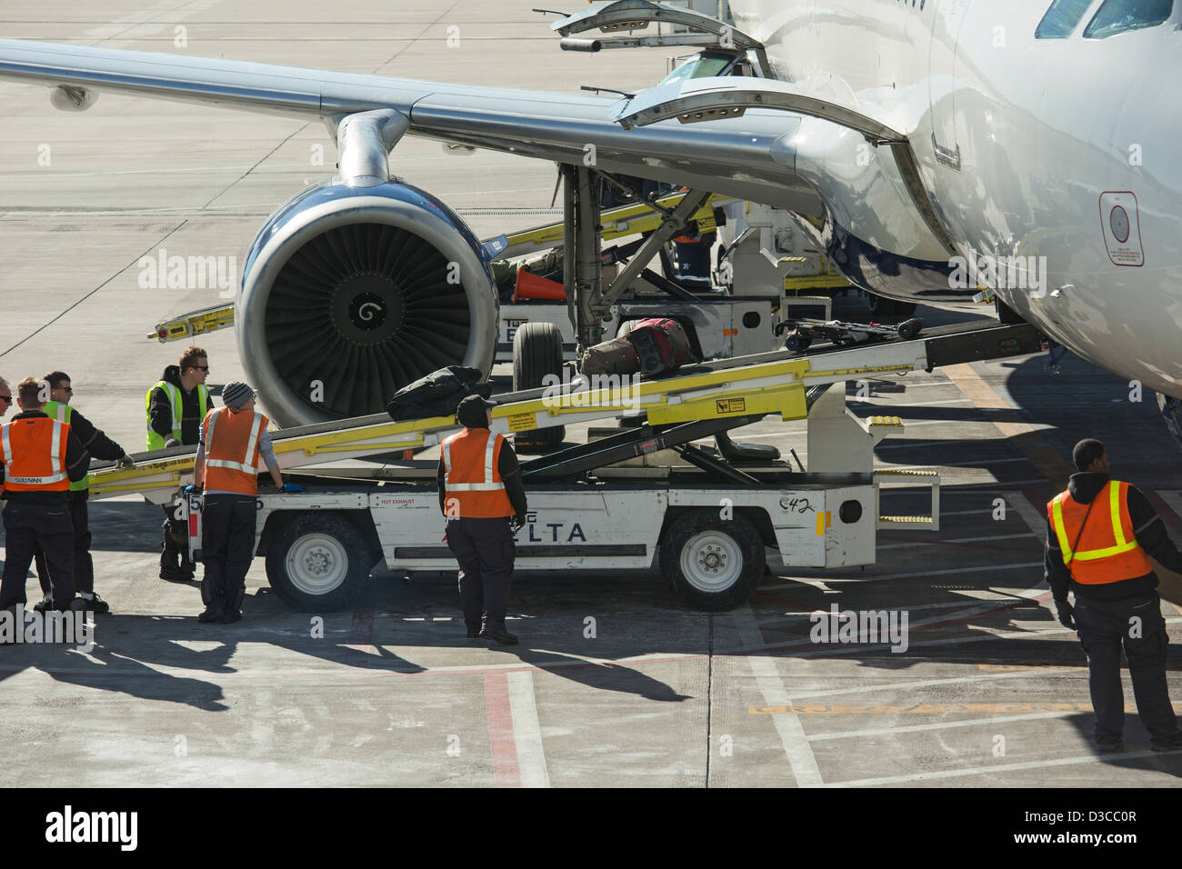 Denver, Colorado   The Ground Crew Unloads Luggage From A Delta Airlines  Plane At Denver International Airport.