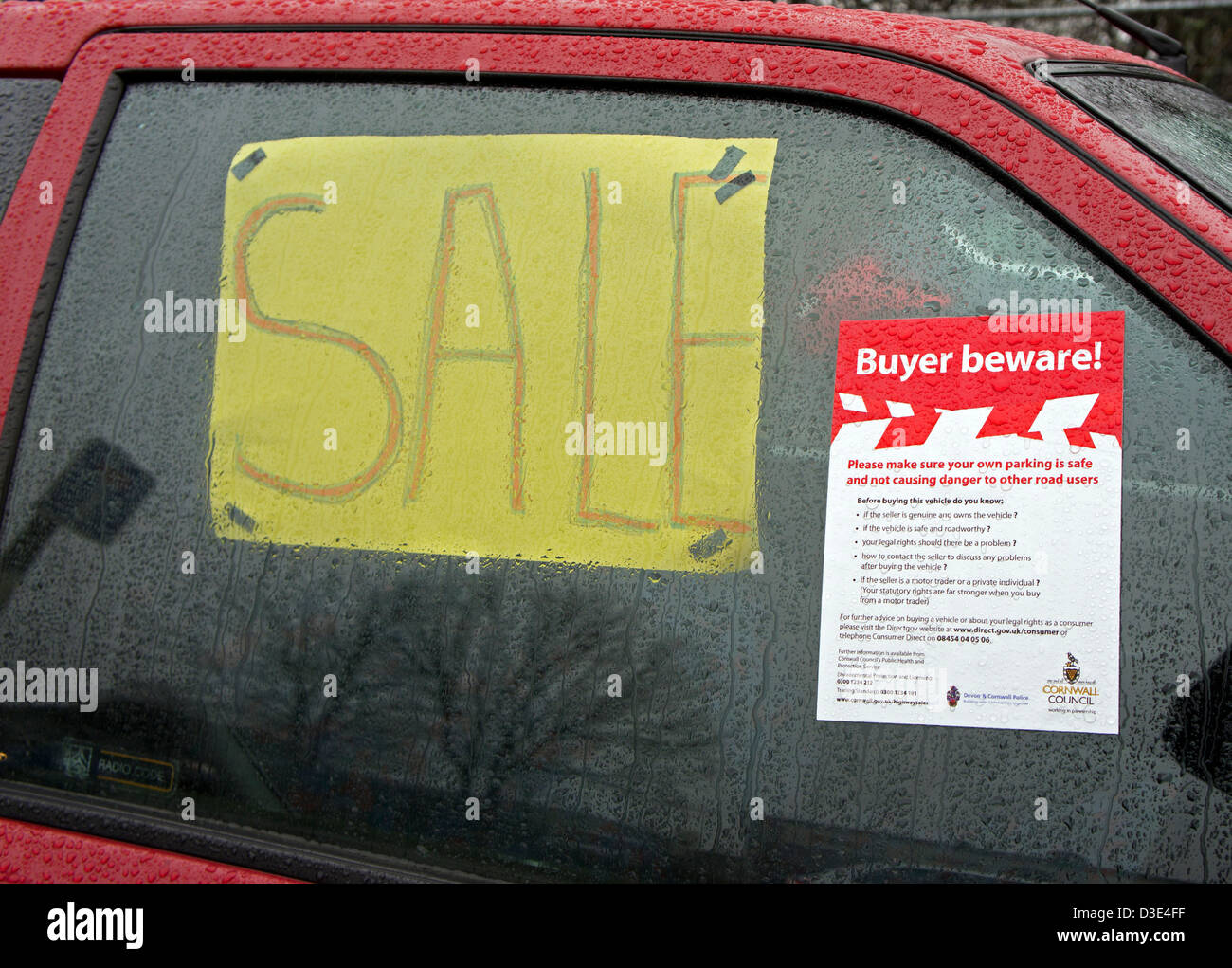 A local council ' buyer beware ' sign on a second hand car for sale by the roadside - Stock Image