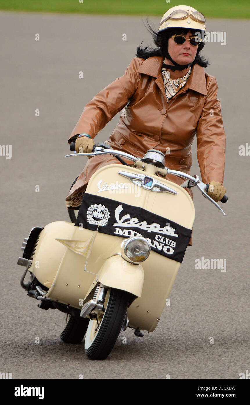 a-girl-in-vintage-clothing-riding-a-classic-vespa-scooter-space-for-D3GXDW.jpg