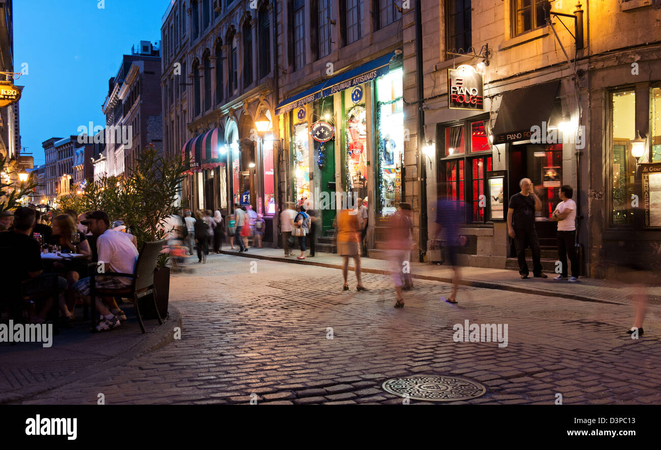 Tourists enjoying Rue Saint Paul Street in district of Old Montreal, Montreal, Quebec, Canada - Stock Image