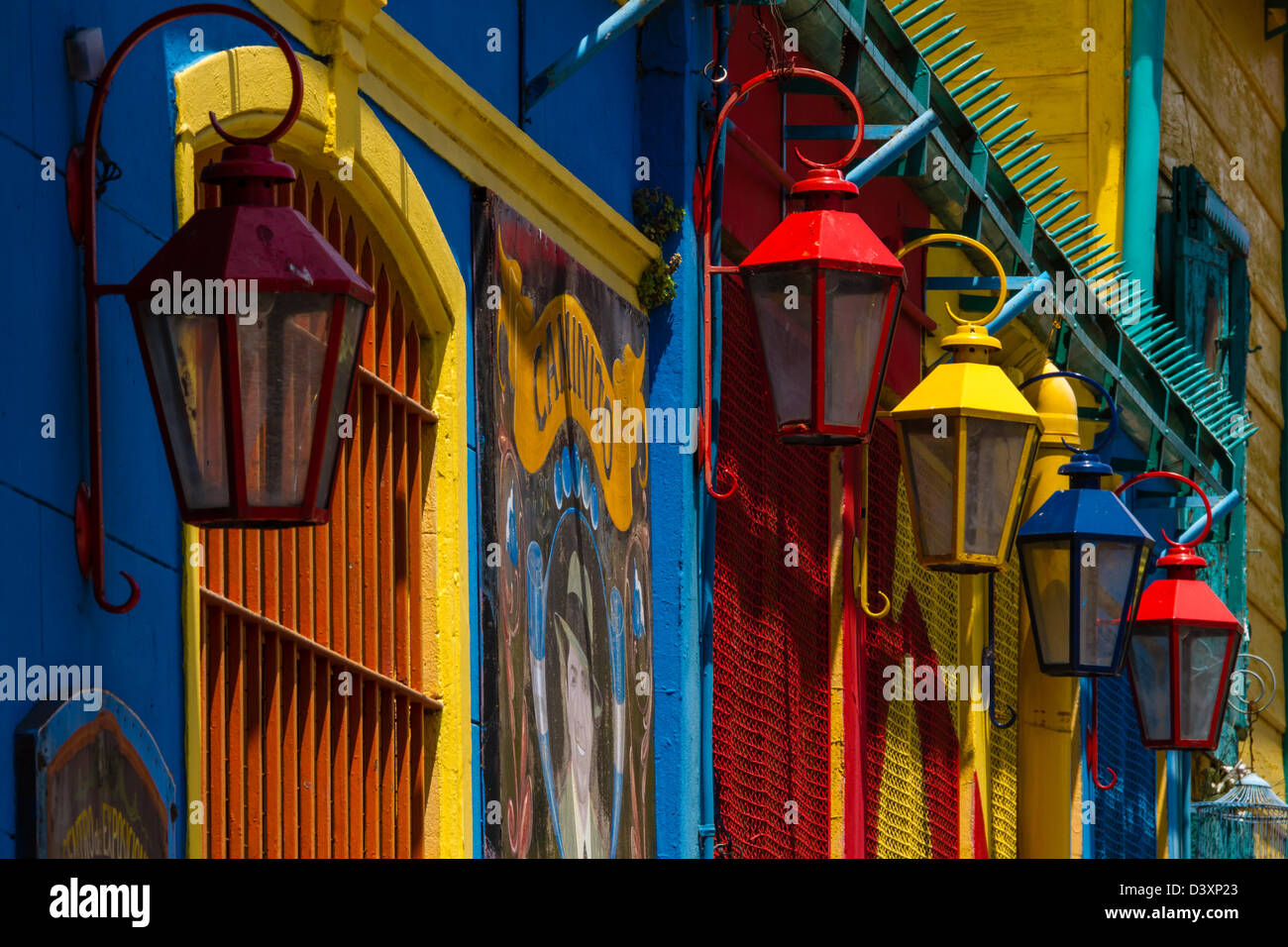 Colourful street lights and vividly painted walls in bright La Boca, Buenos Aires, Argentina - Stock Image