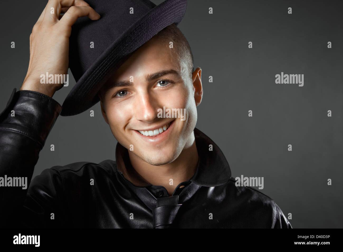 Young caucasian man in men's fashion photo taken in studio - Stock Image