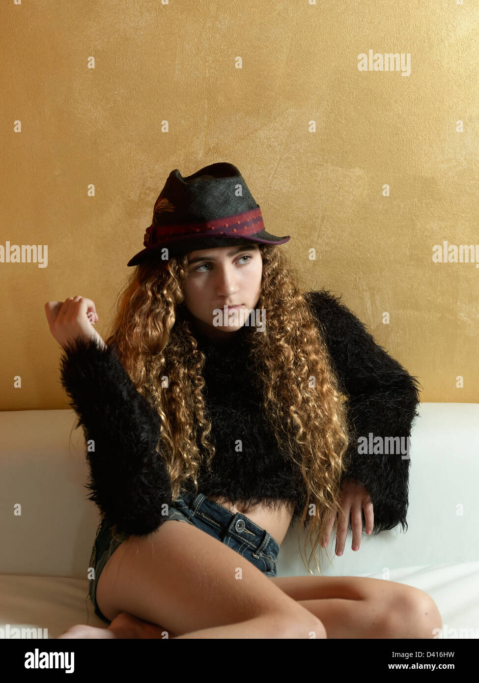 Portrait of a Young Girl with Long Curly Hair - Stock Image