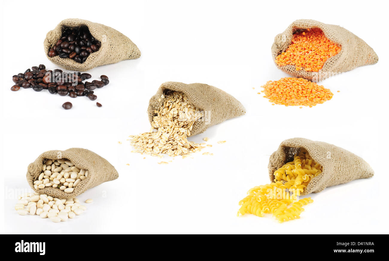 Selection of grains scattered from burlap bags on white background - Stock Image