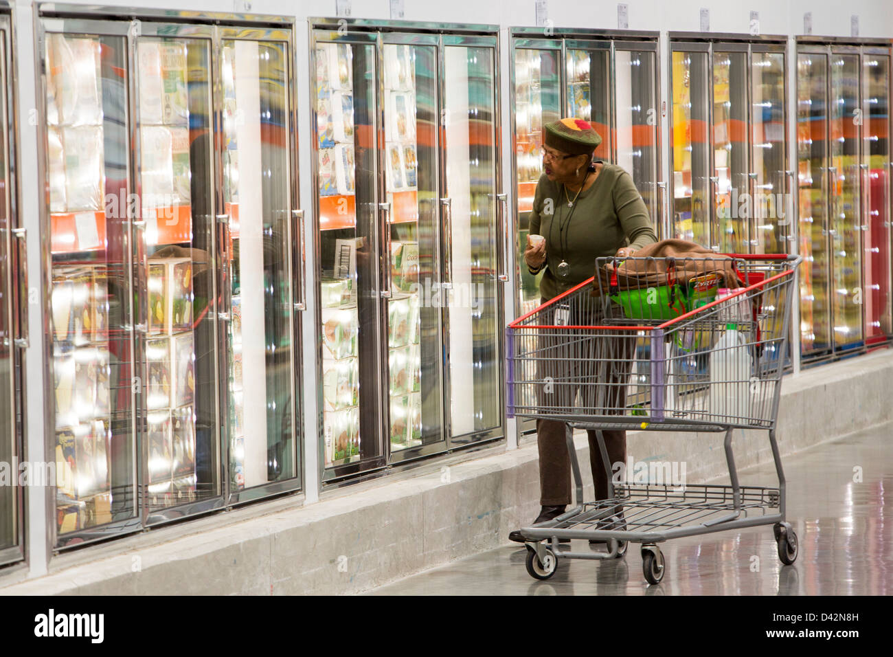 Customers shopping in the frozen foods section of a costco wholesale customers shopping in the frozen foods section of a costco wholesale warehouse club thecheapjerseys Images