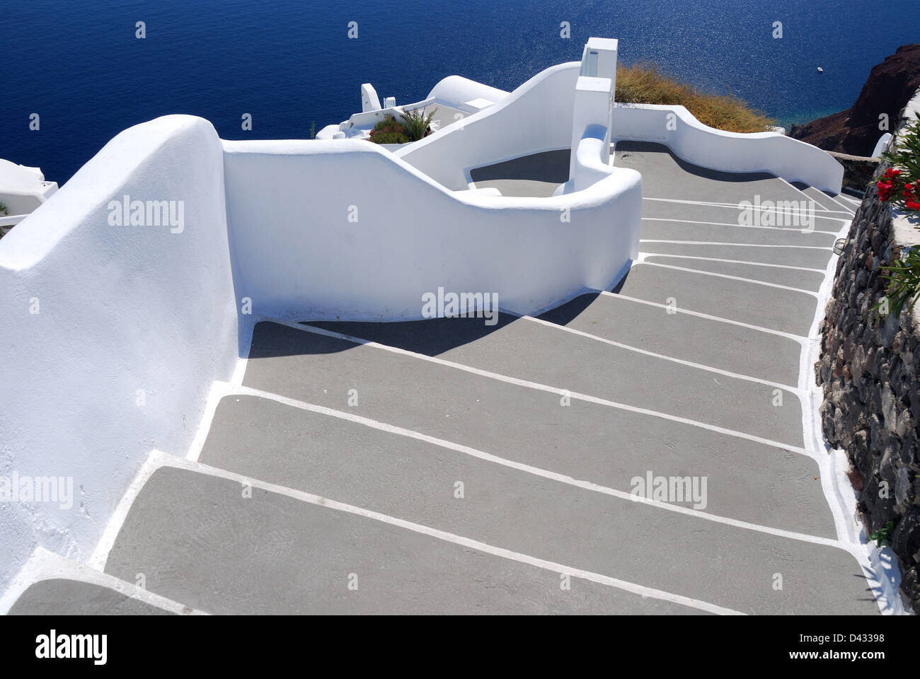 Stairs to sea, Santorini village of Oia, Greece, a popular touristic place for architecture. - Stock Image