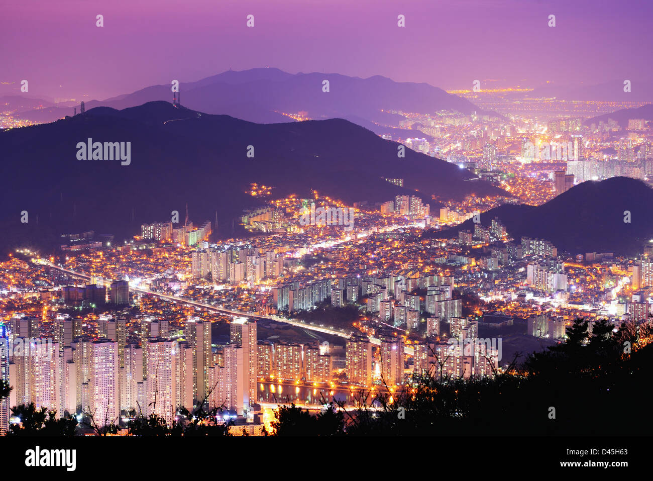 Skyline of Busan, South Korea at night. - Stock Image