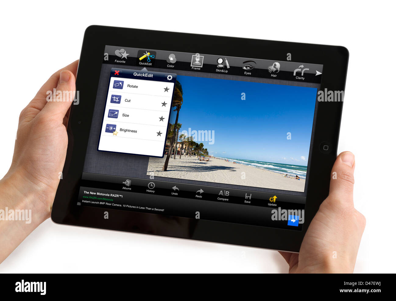 Editing a photograph with the Fotolr HD free app on a 4th generation Apple iPad, USA - Stock Image