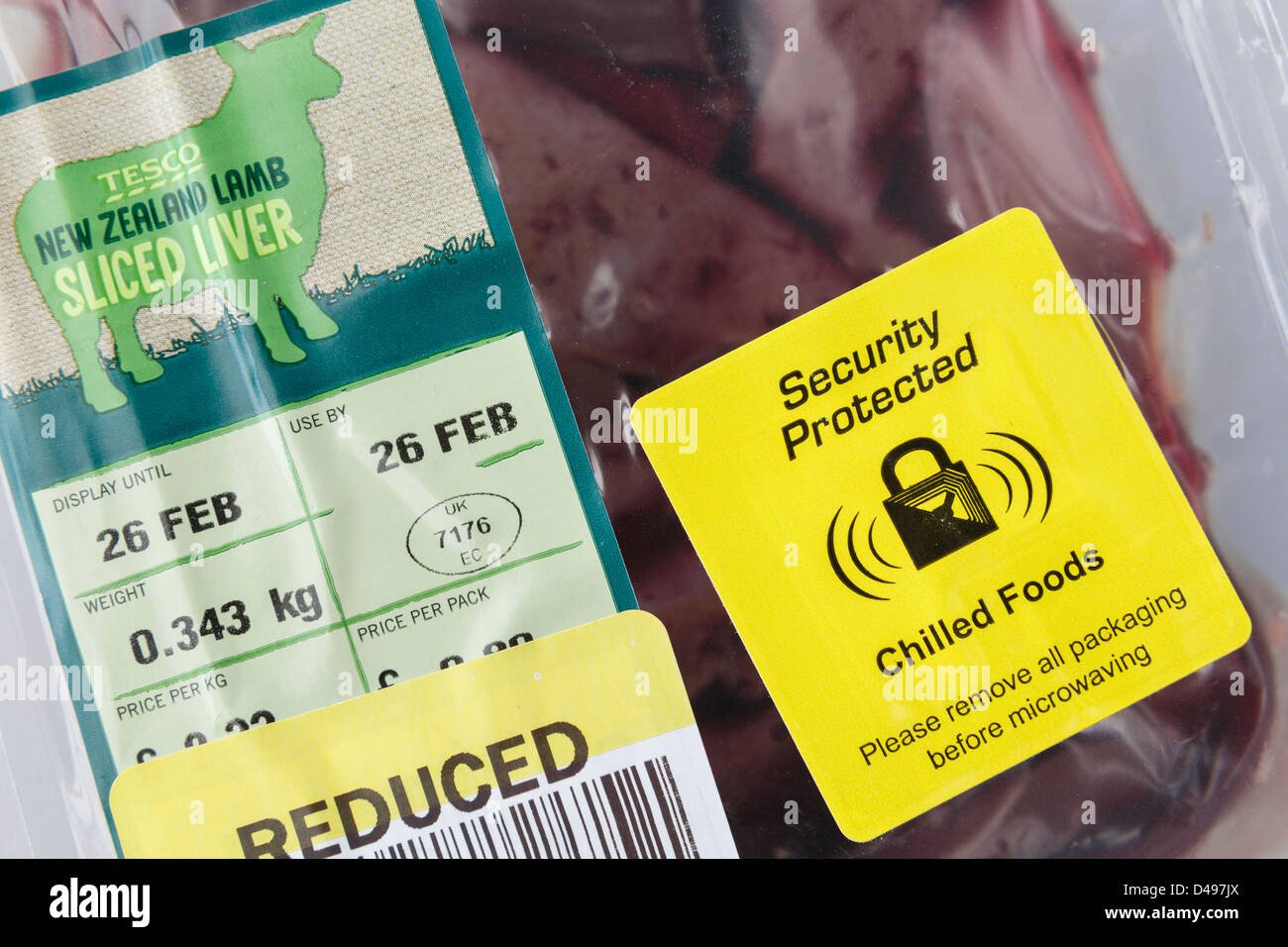 Yellow Security protected label for chilled foods on a reduced packet of fresh New Zealand Lamb sliced liver from - Stock Image
