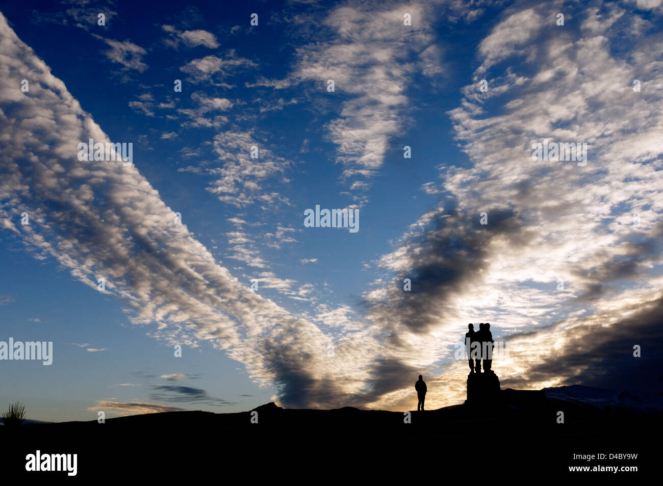 a-person-silhouetted-against-a-dramatic-sunrise-cloudscape-and-the-D4BY9W.jpg