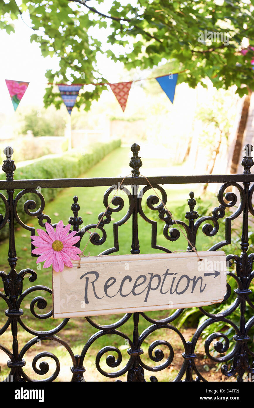 'Reception' sign on wrought iron fence - Stock Image