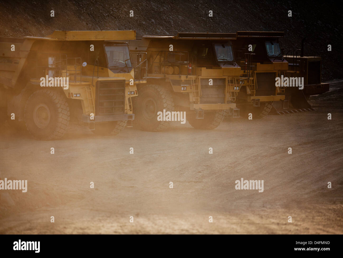 Trucks parked on road in quarry - Stock Image