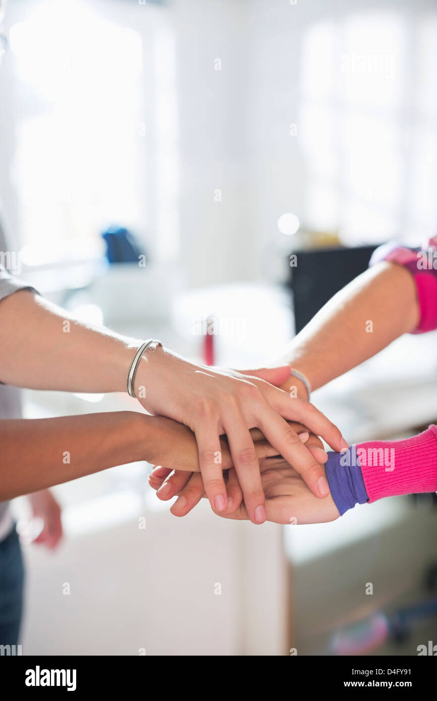 Close up of hands in circle together - Stock Image