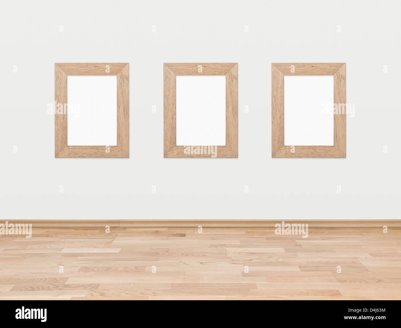 Three empty rectangular wooden frames displayed on a white wall ...