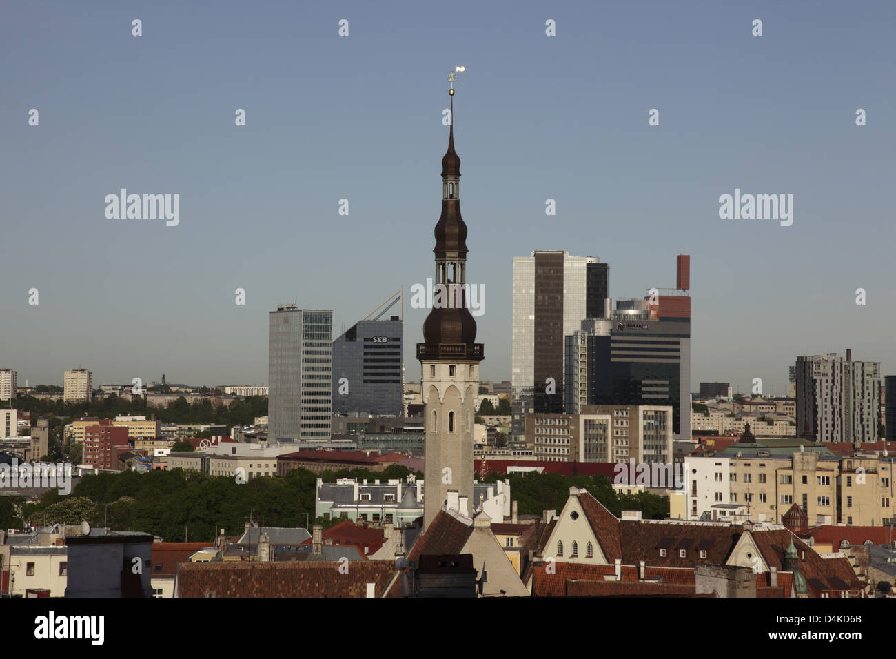 The tower of the the old town hall and modern buildings are pictured in Tallinn, Estonia, June 2009. The old town - Stock Image