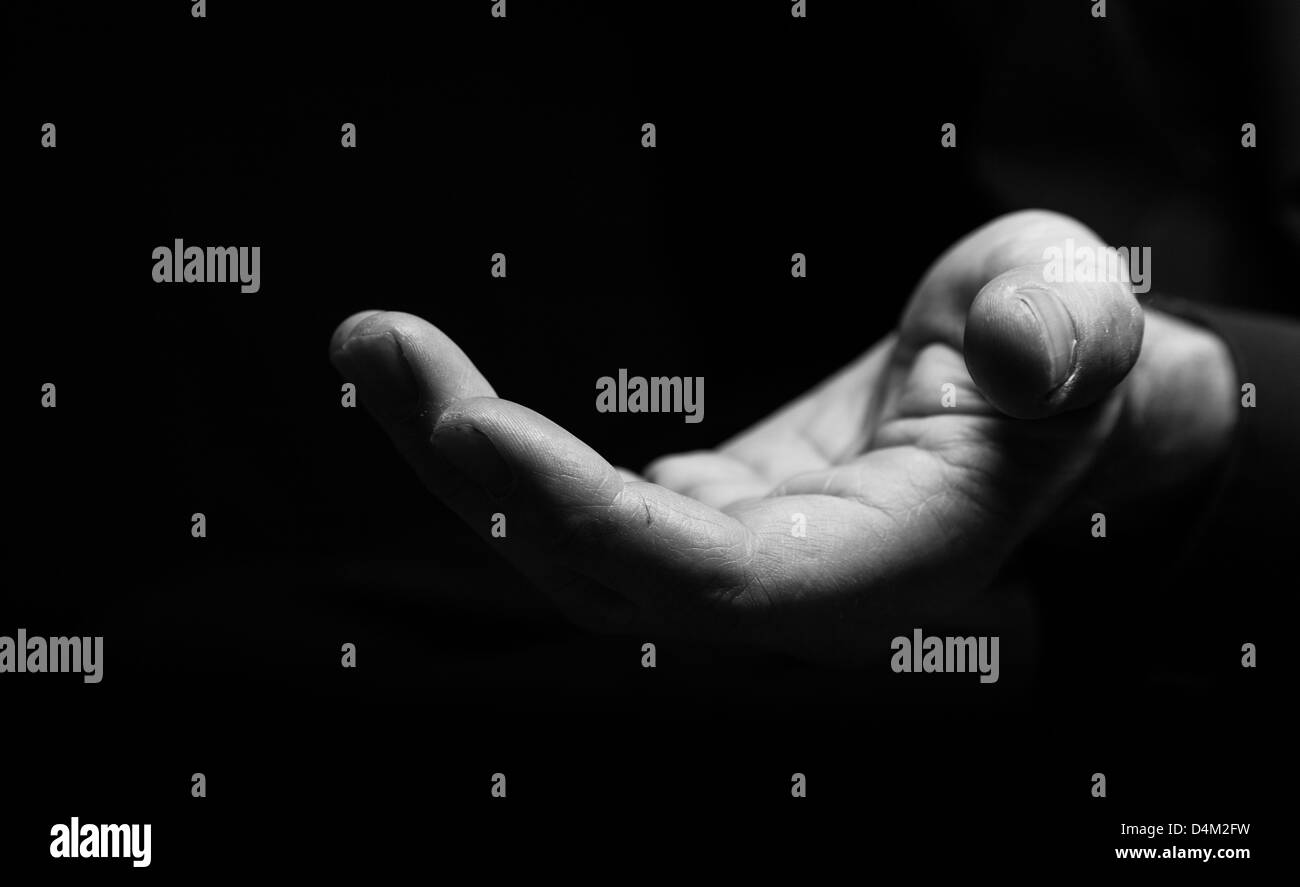 Holding out a hand for Help - Stock Image
