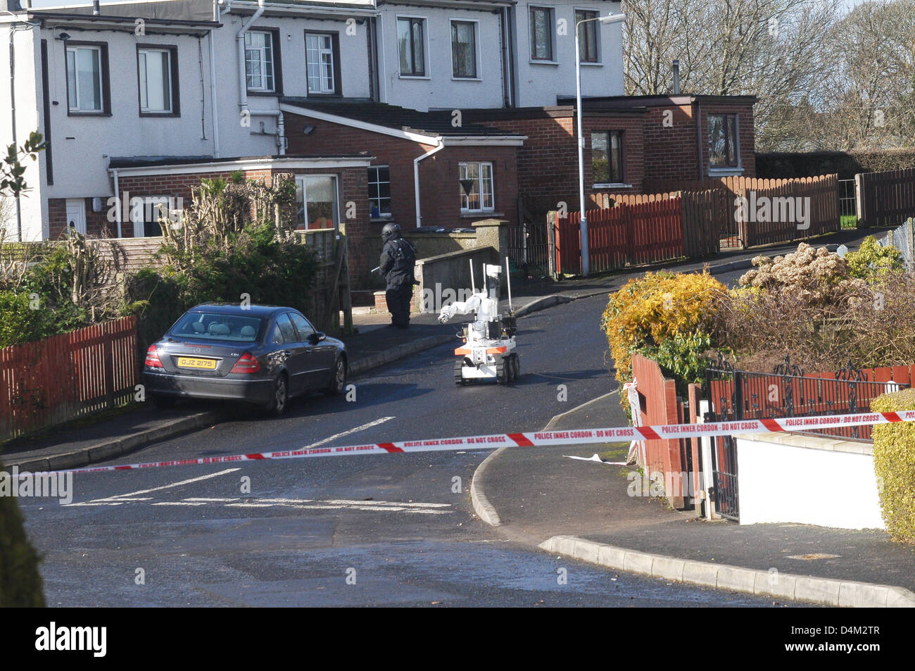 Armagh, Northern Ireland. 15th March 2013. Bomb squad officer approaches a suspected bomb at a house in Alexandra - Stock Image