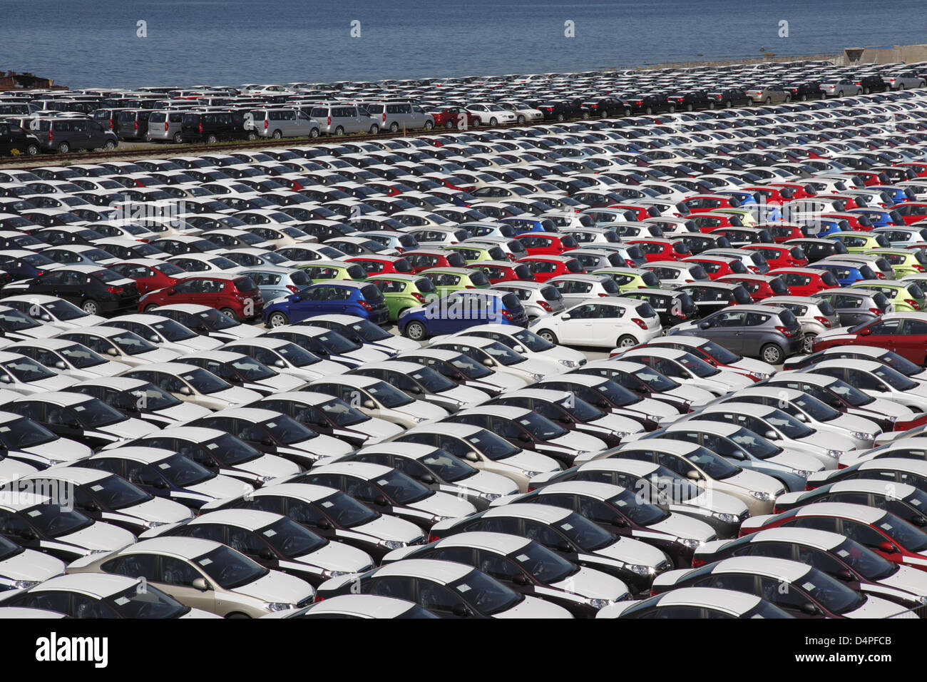 Imported new cars stand in the industrial harbour of Paldiski near Tallinn, Estonia, June 2009. Photo: Willy Matheisl - Stock Image